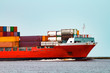 Red container ship underway