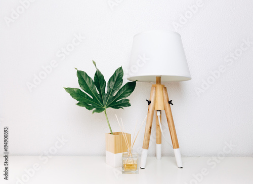 Nordic modern living room with table lamp, home fragrance and tropical leaf Wallpaper Mural