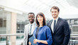 portrait of tree successful businesspeople, business team posing in modern office