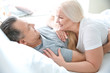 canvas print picture - Senior couple in bed together at home