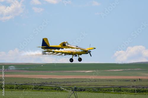 Fotografie, Obraz  Crop Duster spraying field
