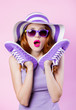 canvas print picture girl in sunglasses and hat holding shoes