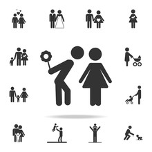 Loving Couple With Hide Flower In His Hand Standing Love Icon. Detailed Set Of Family Icons. Premium Quality Graphic Design. One Of The Collection Icons For Websitesfamily