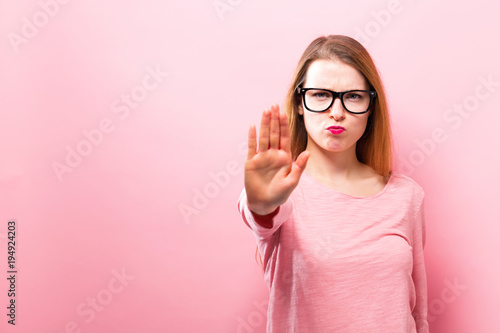 Young woman making a rejection pose on a solid background Fototapeta
