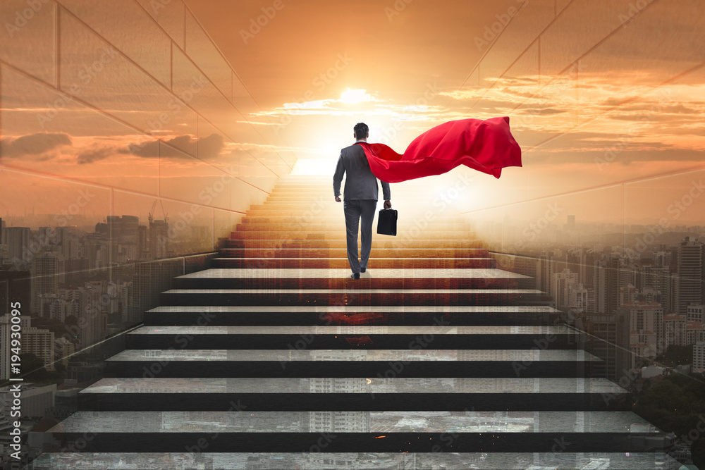 Fototapeta Businessman superhero successful in career ladder concept