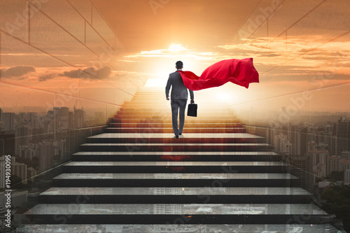 Businessman superhero successful in career ladder concept Canvas Print