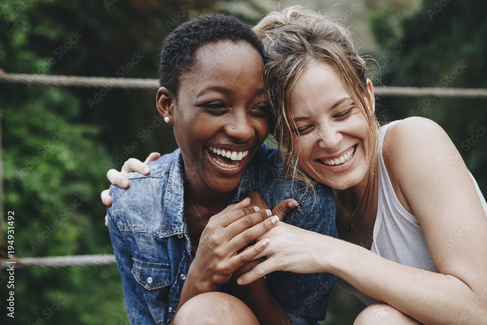Fototapety, obrazy: Happy friends holding each other