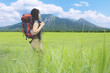 Female hiker standing in the meadow