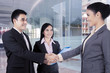 Business people come to an agreement shaking hands