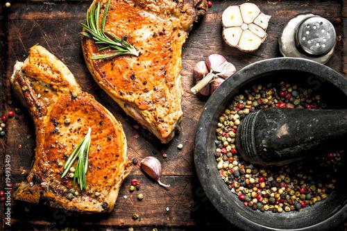 Fototapeta Grilled pork steak with spices. obraz