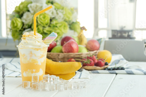 Stickers pour portes Lait, Milk-shake Banana smoothie yogurt with with honey and whip cream and fruit on a wooden table