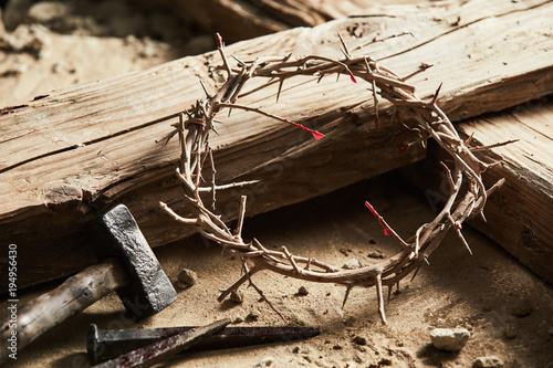 Fototapeta Crown of thorns among cross, hammer with nails