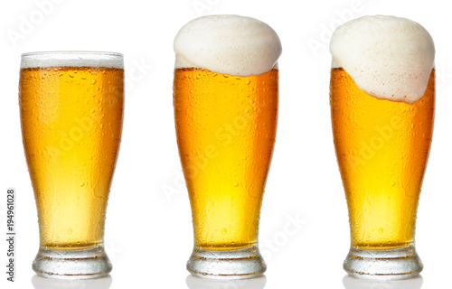 Set of a glass of cold light beer with foam isolated on white background Canvas Print