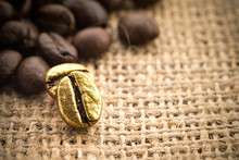 Gold Coffee Beans On A Pile Of...