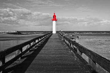 Fototapeta Molo Trouville lighthouse, red selective color, Normandy, France