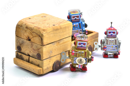 Photo  toy bobot and toy wood car..