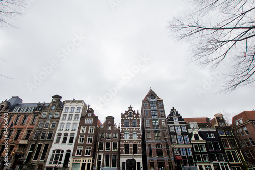 Photo  Multicolored houses in Amsterdam on the main canal of the city