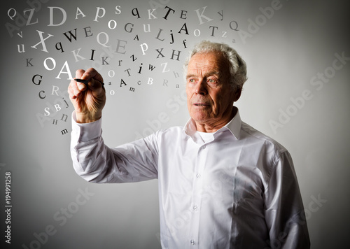Old man is writing something. Letters. Canvas Print