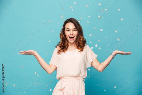 Obraz Portrait of a happy beautiful girl wearing dress - fototapety do salonu