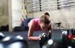 Fitness woman doing push ups in the gym.