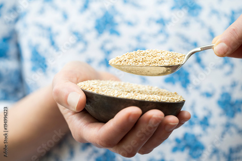 Close Up Of Woman Holding Bowl Of Amaranth Canvas Print