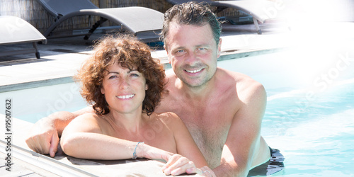 forties couple man and woman in pool summer with sun day Poster
