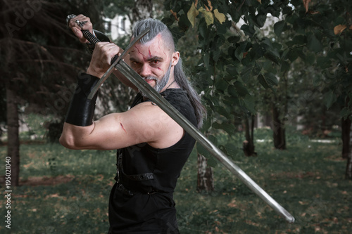фотография сosplay, dressed like a hero Geralt of Rivia from the game the Witcher, a fantas