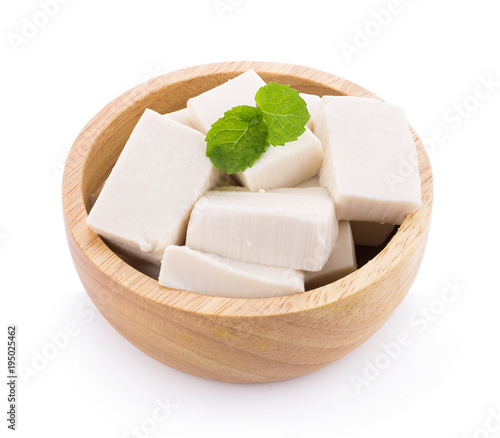 Tofu in wooden bowl isolated on white background
