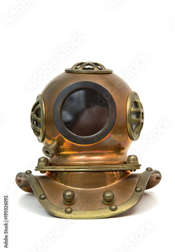 Old brass diving mask isolated on white