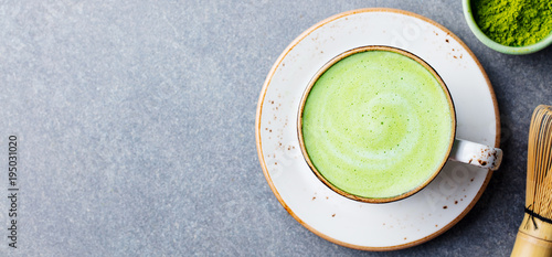 Fotografie, Obraz  Matcha green tea latte in a cup. Top view. Copy space.