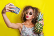 canvas print picture - Beautiful Girl selfie with a smartphone. Beautiful young African American woman with afro hairstyle and sunglasses