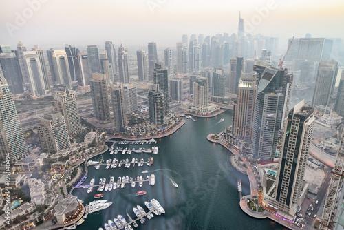 Tuinposter Aerial view of Dubai Marina buildings at dusk
