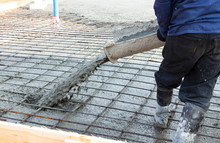 Closeup Shot Of Concrete Casting On Reinforcing Metal Bars Of Floor In Industrial Construction Site