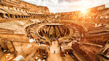 Inside The Colosseum Or Coliseum In Rome, Italy. Panorama At Sunset.