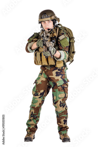 Cuadros en Lienzo  Portrait soldier or private military contractor holding sniper rifle