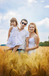 family in a wheat field. selective focus.
