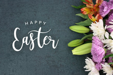 Spring Season Still Life With Happy Easter Holiday Script Text Over Dark Black Background Texture With Beautiful Colorful White, Pink, Orange, Purple And Green Flower Blossoms Bouquet