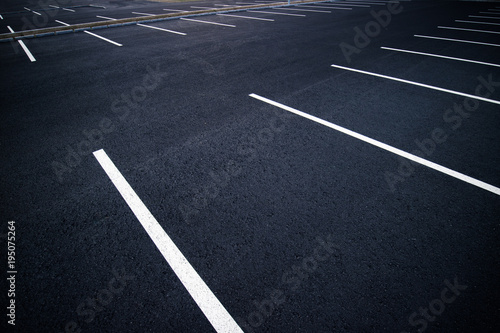 Leinwand Poster Acres of empty parking spaces