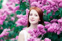 Girl In Lilac Garden In Spring...
