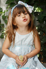 Little Cute Girl Holding Fluffy Chick And Sending A Kiss. Happy Easter