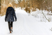 Woman Walking In Snow In Winte...