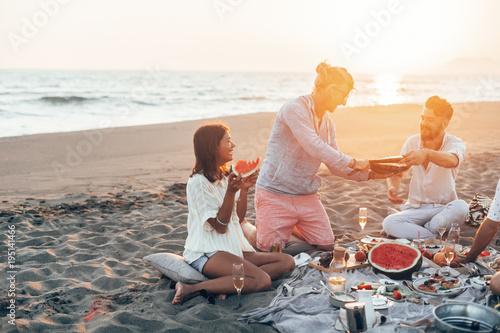Valokuva  People Having Beach Picnic