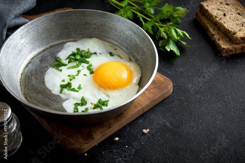 Deurstickers Gebakken Eieren Fried Egg on Frying Pan for Breakfast