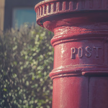Traditional Red Pillar Box Post Drop In A Residential Street In Glasgow, Scotland, UK
