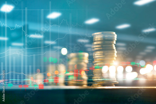 Fototapeta Finance and business investment concept. Graph and rows with statistic growth of coins on table. obraz