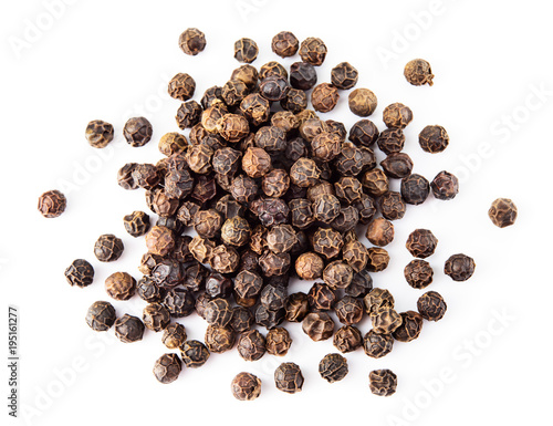 Black pepper. Heap of peppercorns isolated on white background. Macro. Top view.