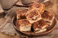 Pile Of Cinnamon Swirl Coffee Cake On A Wooden Plate