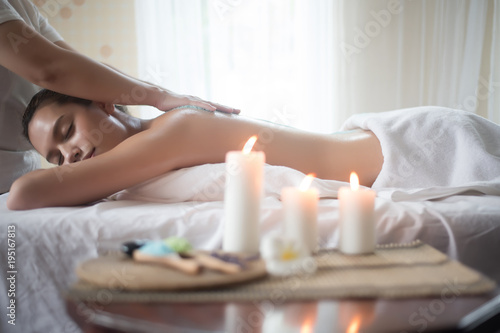 Garden Poster Spa Beautiful woman getting a salt scrub beauty treatment in the health spa.