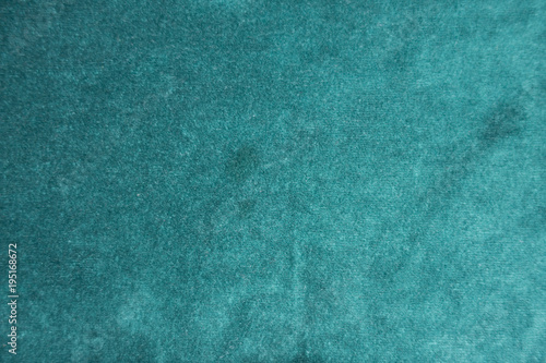 Tuinposter Stof Surface of dark green napped fabric from above