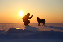 A Man With A Dog At Baikal Lake